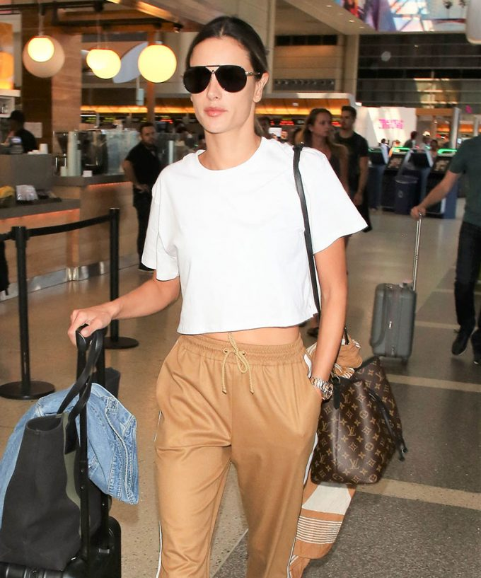 f5c2392309a3 We Buy Celebs Flock Through LAX and Rep Their Teams with Bags from Louis  Vuitton